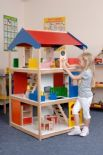 Giant Dolls House with furniture and dolls.